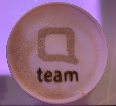 qteam logo on coffee